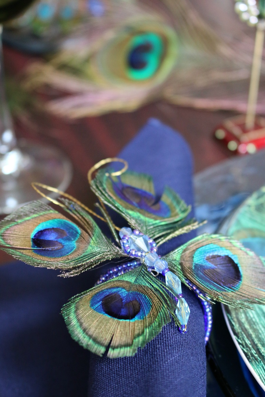 Peacock Napkin Ring - sometimes by purchasing one thing you love, you can build an entire Table Scape. Like this Peacock inspired Table Setting.