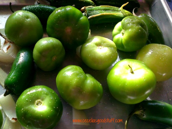 Place tomatillos, jalapenos and onion on greased cookie sheet