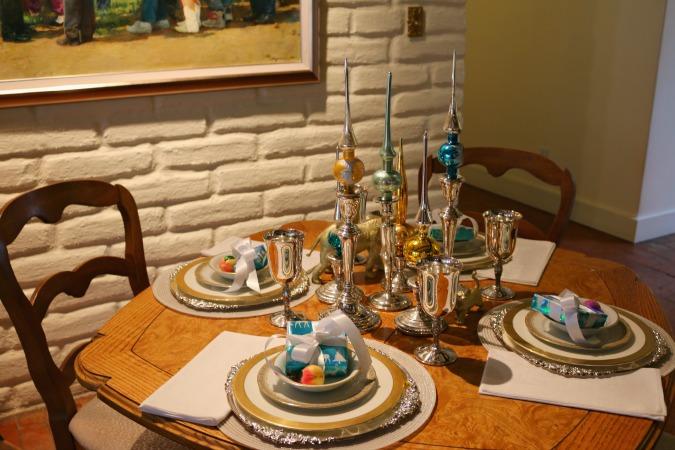 Intimate Formal Table with fine china. Tree toppers in candle sticks make up the centerpiece.