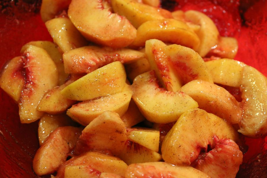 Slice and peeled covered in cinnamon, nutmeg, vanilla bean paste and fresh lemon juice. These beautiful peaches were ready to be put into the pie crust.