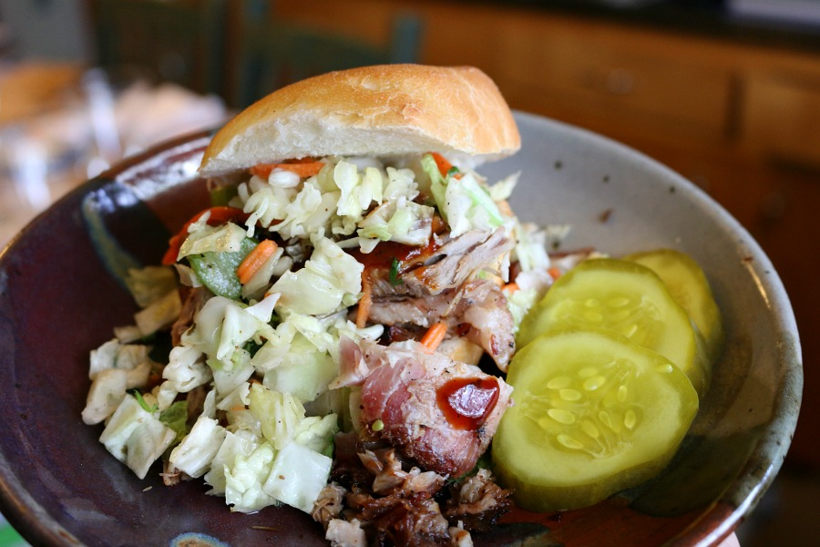 Delicious Spicy Pulled Pork Sliders topped with coleslaw.