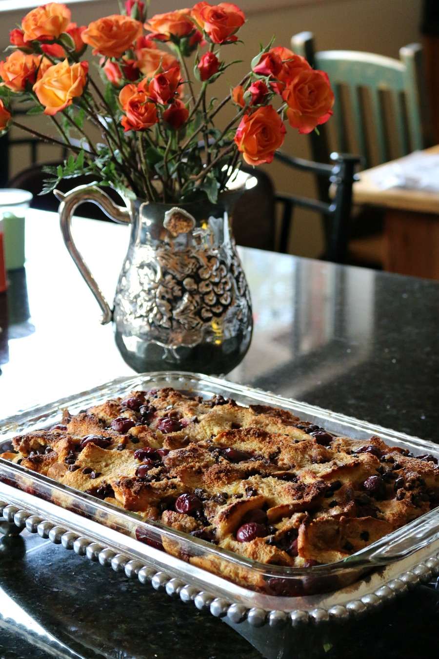 This would be the perfect brunch recipe. The perfect dessert, warm bread pudding with cherries and dark chocolate. Topped with whipped cream and hot fudge sauce. Decadent and delicious. || www.ceceliasgoodstuff.com