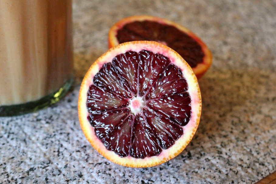 A Blood Orange is very beautiful. No worry it is not GMO, it is a nature occurring mutation.