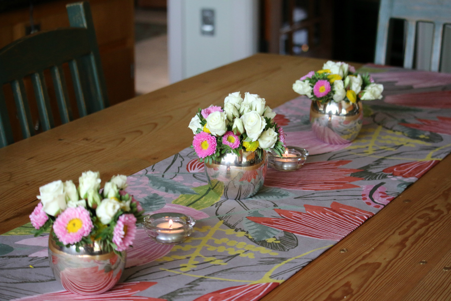 I enjoy fresh flowers . . . it was my son's birthday so I wanted to make the table look nice for his birthday dinner. I grouped three small floral centerpieces for a beautiful statement.