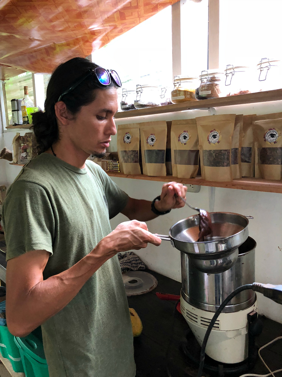 George melting the cocoa down to make chocolates and hot fudge with fresh cocoa. La Iguana Chocolate Costa Rica